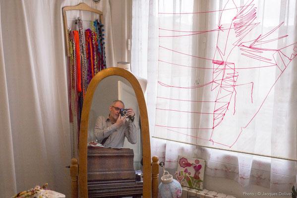 Le travail de SyEym, et le reflet d'un photographe...