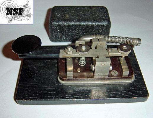 Made by N.S.F. Nederlandsche Seintoestellen Fabriek.  (Dutch signal equipment factory).