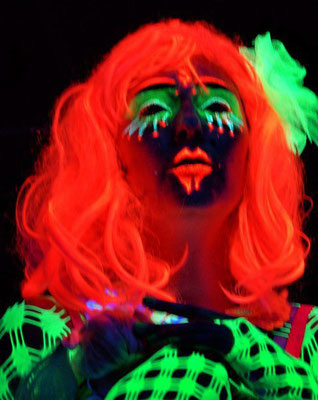 Blacklight paintings and performances own costume design