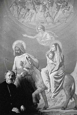 """Amedeo Trivisonno ritratto davanti alla grande tela raffigurante il """"Secondo Dolore di Maria: la fuga in Egitto"""", per il Santuario dell'Addolorata di Castelpetroso (1972/1975)"""