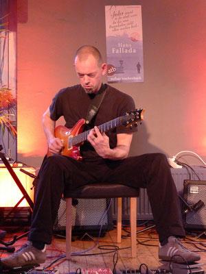 Szenische Lesung mit musikalischer Begleitung von Dirk Mündelein