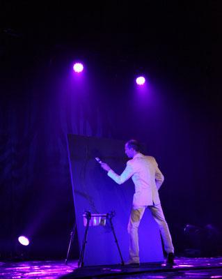 glue painting on stage by EriK Black