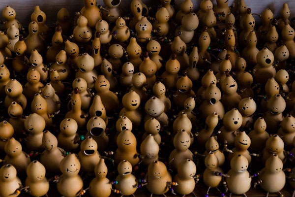 My wife makes cute dolls out of ひょうたん.  Here is a small army of her dolls, before being sold at a festival.