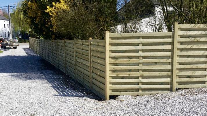 Pose de panneaux de jardin en bois par BLS