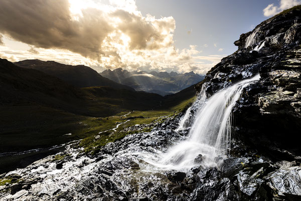 Waterfall above Lej Languard with St. Moritz in the background