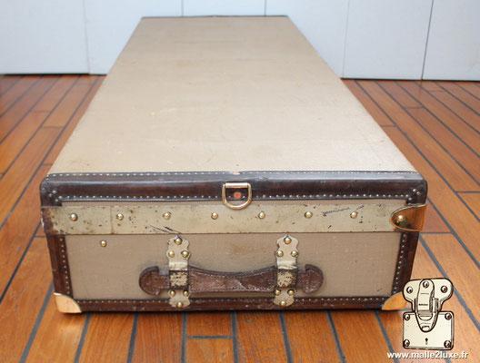 Malle limousine Moynat beige coté de malle bordure cuir