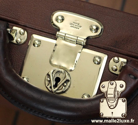 Louis Vuitton steel suitcase push lock