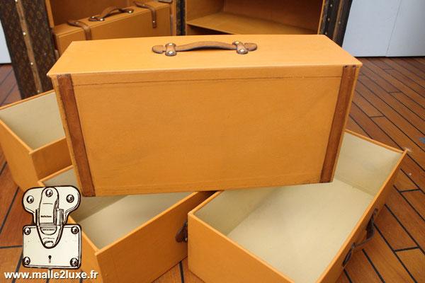 dessous malle tiroir Louis Vuitton