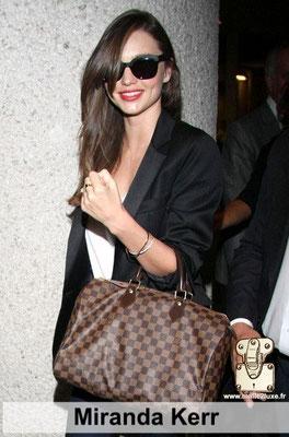 Miranda Kerr est un manequin qui adore les sacs a damier Louis Vuitton