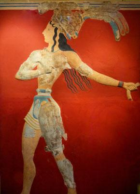 """Der """"Lilienprinz""""-es zeigt einen mit Lilien geschmückten jungen Mann, bekleidet mit Lendenschurz und Tasche. Die Bedeutung ist bis heute unklar."""