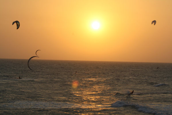 Kitesurfing at sunset
