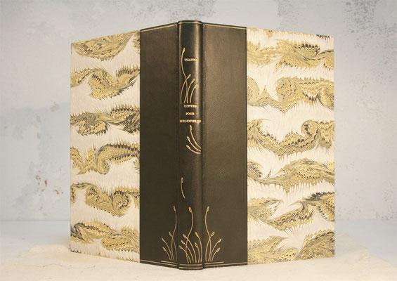 reliure 1/2 peau chagrin, décors à la feuille d'or ( création aux fers courbes)