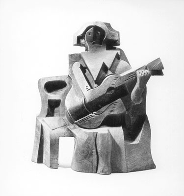 Arlequín sentado con guitarra