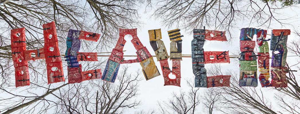 HEAVEN, 2017,  18' x 5' outdoor installation,  life vests, acrylic, bamboo