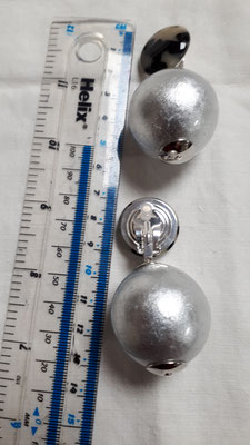 Large silver globes with torty bouton clips, €89. Lightweight