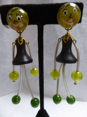 French galalith earrings, girl shaped. 9 cm long. ca 1940. € 110