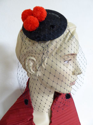 Black Forest with red pom poms and spotted tulle....... €59