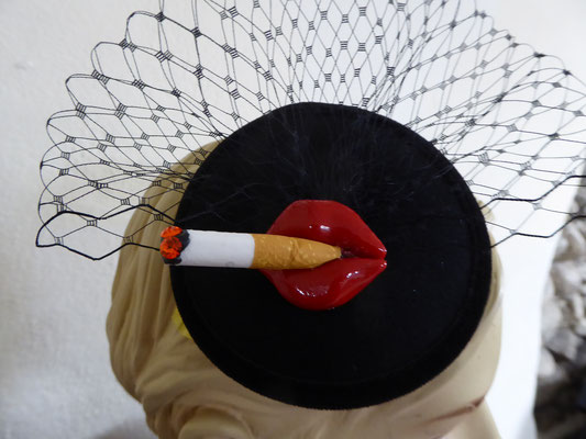€49 black base, black tüll and a comb on back.....Lips with cigarette