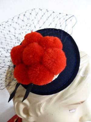 "Sinamay base with ""Bollenhut"" and tulle in black, pompom hat miniature....Black Forest icon €29"