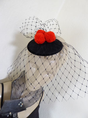 Black Forest with red pom poms....... €59