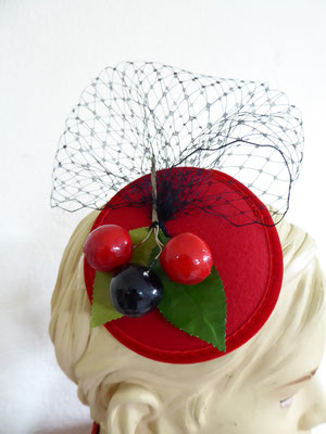 red velvet base with black netting and vintage cherries. €69