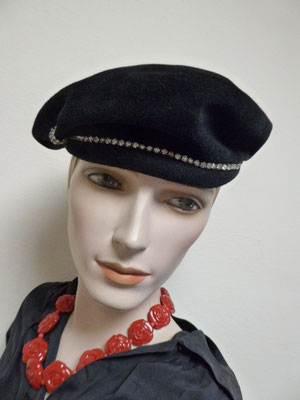 Forties black velvet beret style. Rhinestones. Interesting shape. Lovely condition. €95