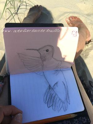 Zeichnen am Strand