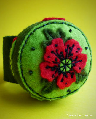 Green wrist pincushion with red poppies