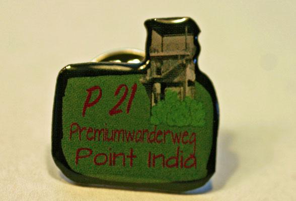 Der Ansteckpin zum P21 Point India, unterstützt Ausstattung und Pflege des Wanderwegs, kann vor Ort oder auch online, info-luederbach@t-online.de, bestellt werden.