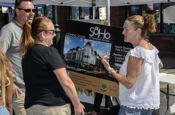 Councilwoman Erin McElroy Barker chats with visitors at Fanny Wood Day about the new Soho mixed use project to be constructed on South Avenue at 1st Street across from the post office.