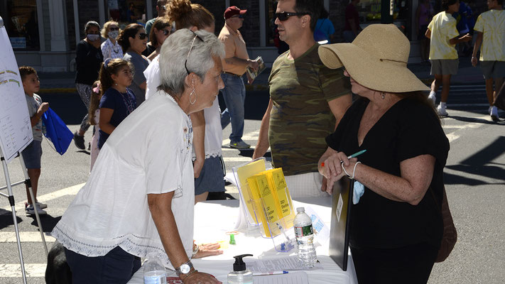 Councilwoman Trisha Walsh chats with visitors to the Fanwood table during Fanny Wood Day