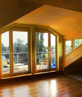 Dachgaube in einem Holzhaus