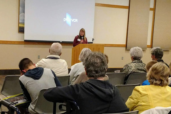 Next, at the podium, Debbie Albert invited everyone to the Historical Society's annual dinner on November 8 :: photo by Lindsey Kult.
