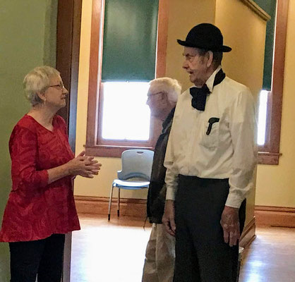 Linda Kolk chats with Schoolmaster Robert Boehm.
