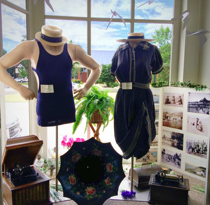 Our display features two 1920s bathing suits with the lady showing her bloomers!