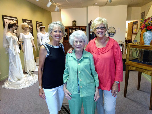 Daughter Mary Weeber, mother Genevieve Huizenga and daughter Elayne Matthysse. NOTE: The wedding dress displayed on the far left was worn by Genevieve in 1945. The middle dress was worn by Elayne in 1967. ::photo by Arlene