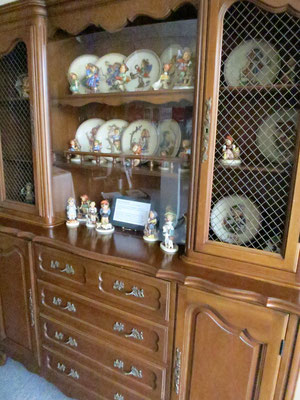 Hutch with drawers and grill. The hutch is filled with 50 pieces from the Hummel Collection of Fran Baron, donor.