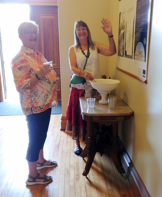 Debbie serves punch in the foyer of the New Groningen Schoolhouse.