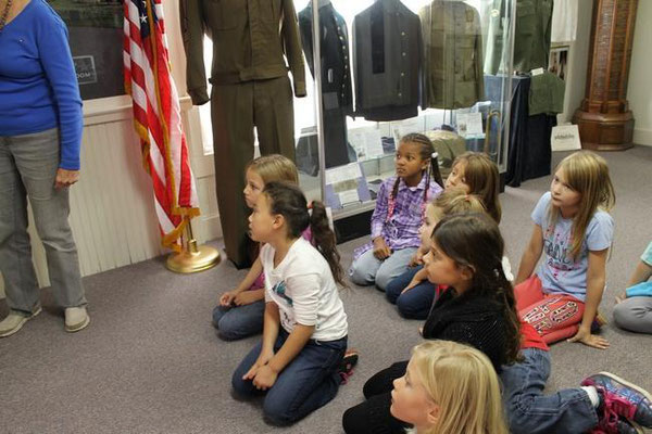 Volunteer Donna Kiel tells them about Zeeland veterans. Erin Dietzer/Sentinel Staff