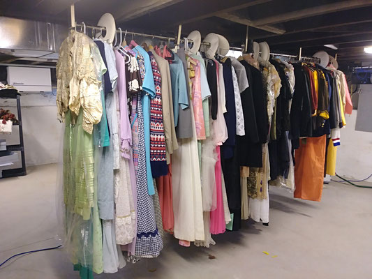 Vintage clothing awaits proper documentation, cleaning and storage.