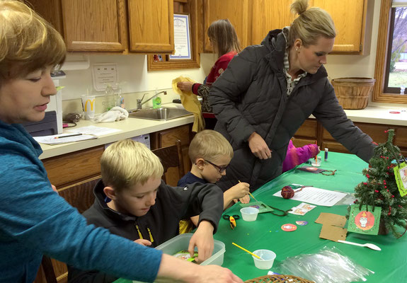 Making an ornament for their Christmas tree