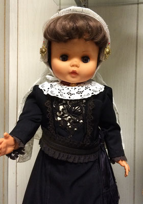 Dutch doll is dressed in material taken from the dress in the next photo