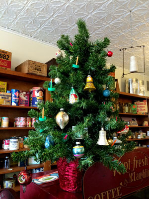 This tree in the Huizenga Grocery Store is loaded with antique Christmas ornaments.
