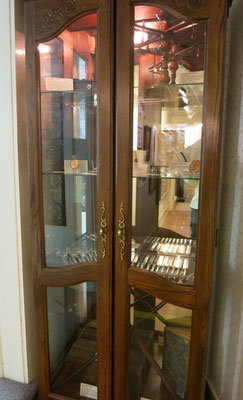This antique cabinet houses the many valuable treasures donated by Dr. G. Craig Baert