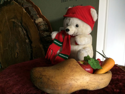 Snow bear guards a vintage wooden shoe set up for Christmas.