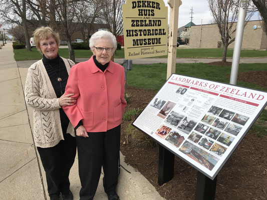 Susan Norder, left, and Dorothy Voss collaborated on the design, the text and photos for the Dekker Huis interpretive sign.         (photo by Ken Kolk)
