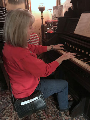 Playing the old pump organ (photo by Susan)