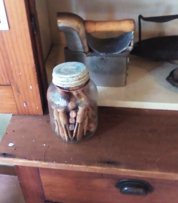 Vintage clothes pins in an old jar unearthed by Arlene, museum volunteer