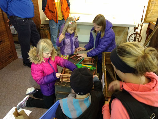 Building a log cabin with Lincoln logs ::photo by Arlene Steenwyk
