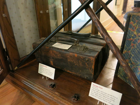 The medical bag and wooden cane were used in the early 1900s by Dr. George Henry Baert